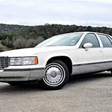 A handbag with a car included: 1993 Cadillac Fleetwood Brougham