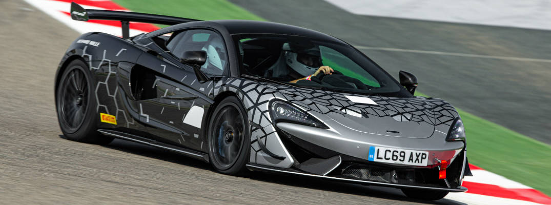 This image has an empty alt attribute; its file name is Silver-and-black-2021-McLaren-620R-driving-on-a-racetrack_o.jpg
