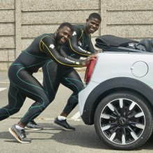 Jamaican bobsled team practices push starts with a Mini
