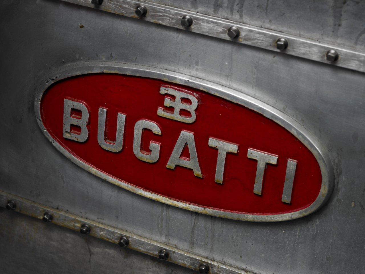Patina on a vintage Bugatti Macaron badge.