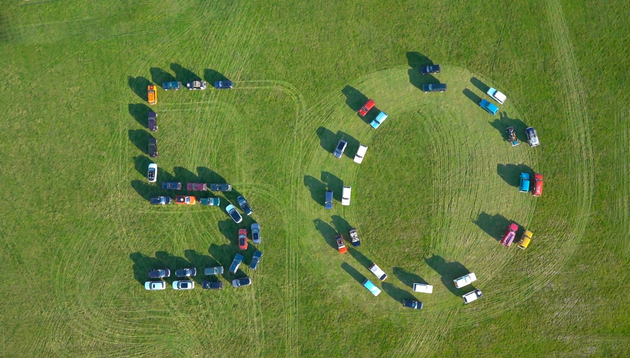 """50 Range Rovers parked for an aerial """"50"""" photo at Land Rover's 50th anniversary party."""