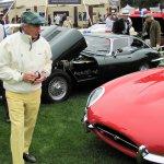 Jackie Stewart in his trademark plaid cap listens to the 1953 Ferrari run