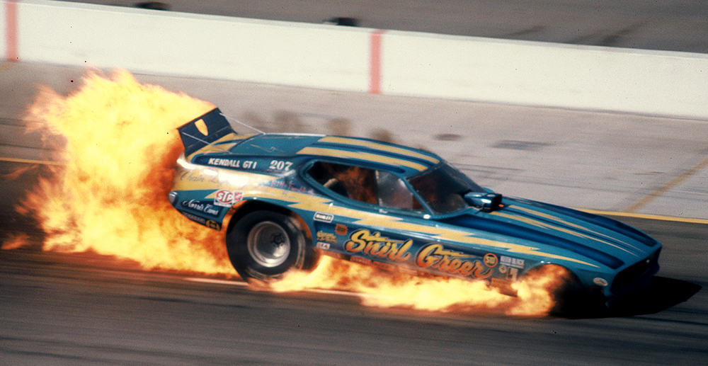 Shirl-Greer-Mach-1-Mustang-Funny-Car-Chain-Lighting-at-OMS-in-flames-1974-World-Finals-Howard-Koby-photo-copy.jpeg