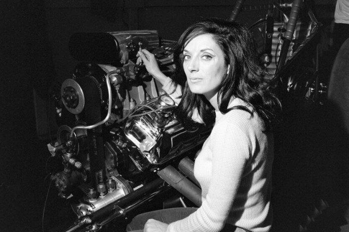 Petersen Automotive Museum women working on car engine