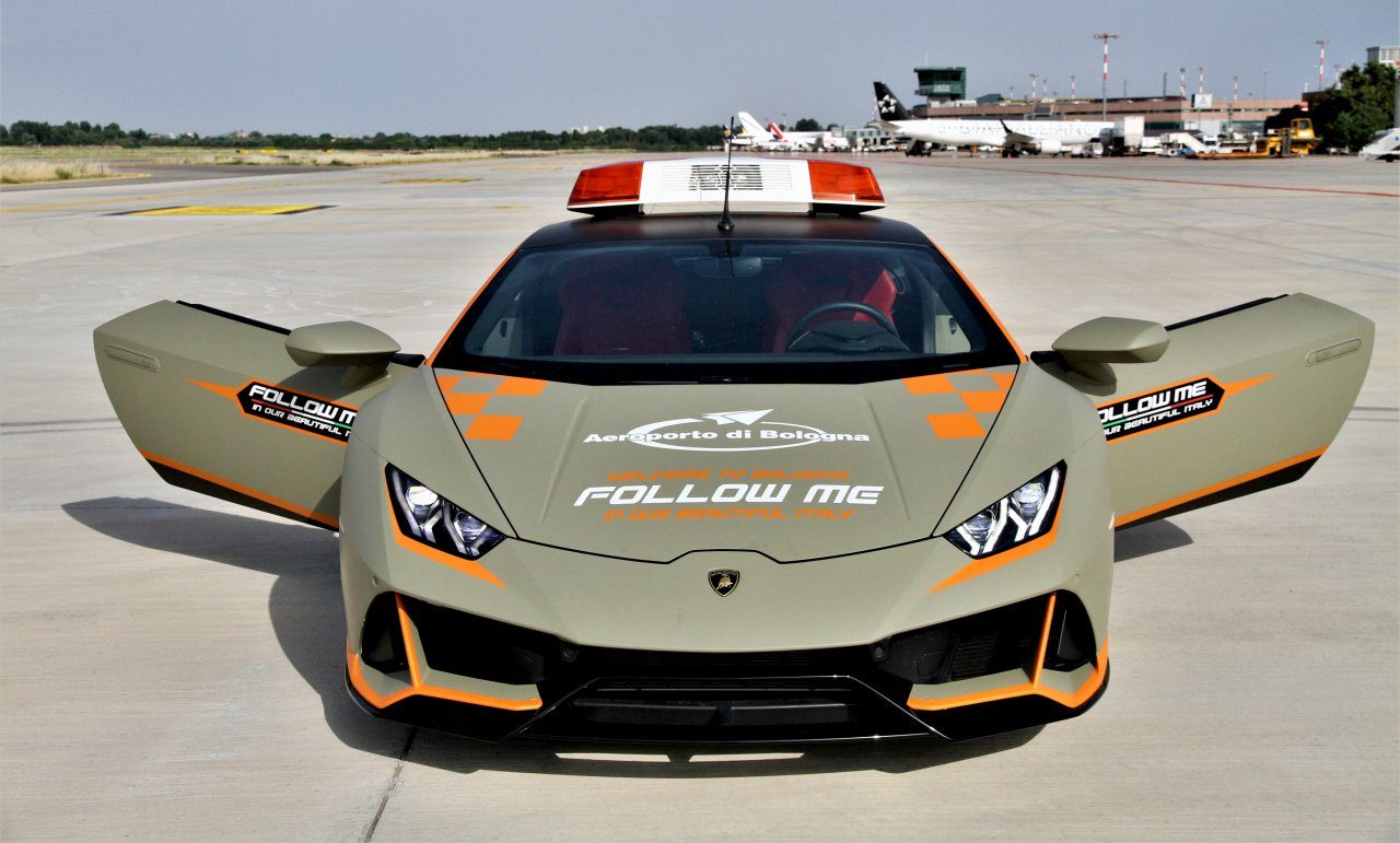 Lamborghini, Wonder if the aircraft can keep up with the Lamborghini, ClassicCars.com Journal